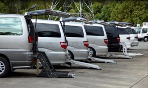 row of vans with ramps unfolded