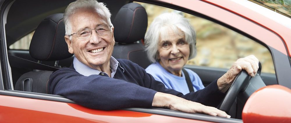 elderly man and woman in car